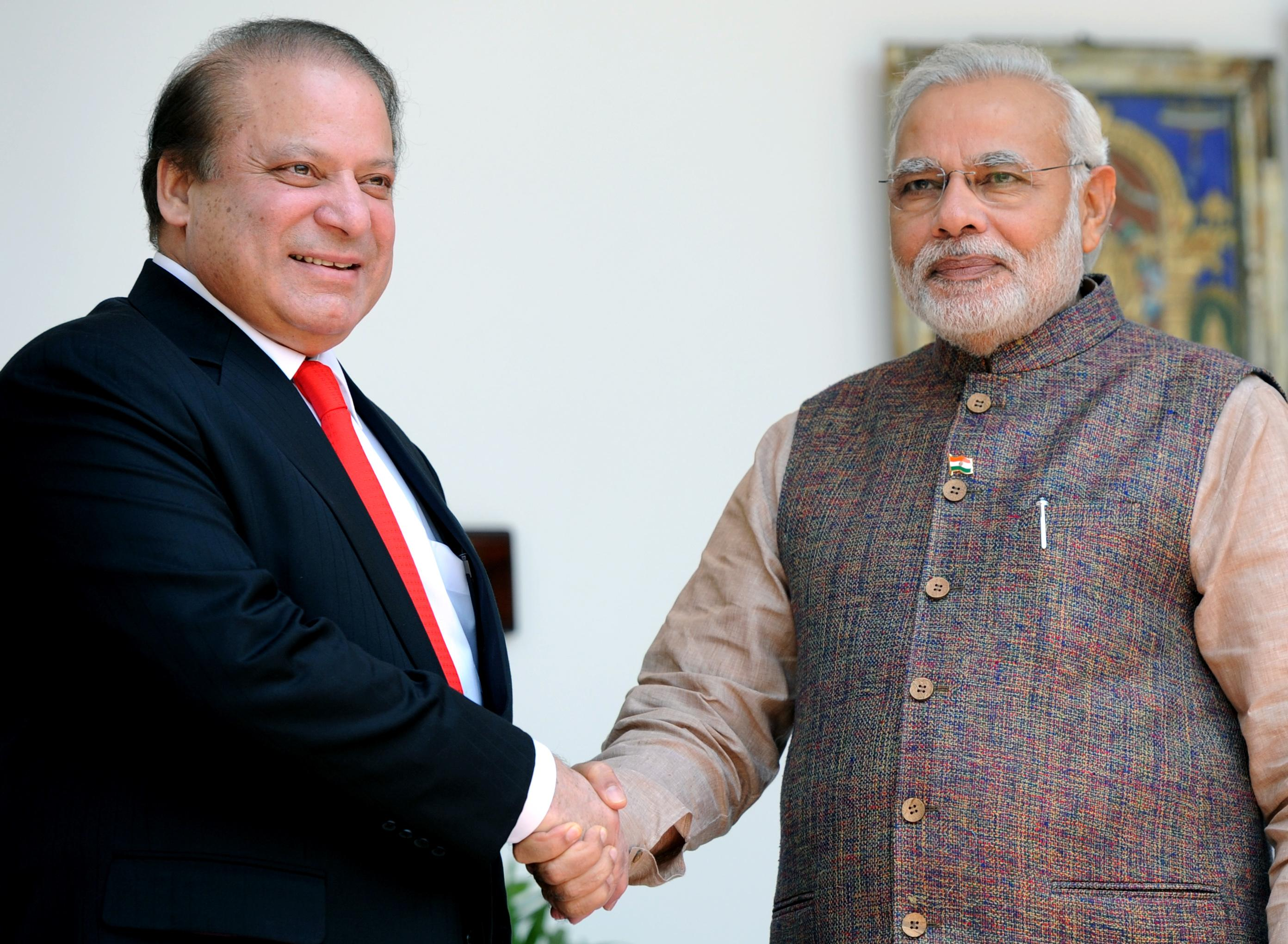 Prime Minister Narendra Modi (R) shakes hands with his Pakistani counterpart Nawaz Sharif (L) during a meeting at Hyderabad House in New Delhi on May 27, 2014. (Photo: IANS)