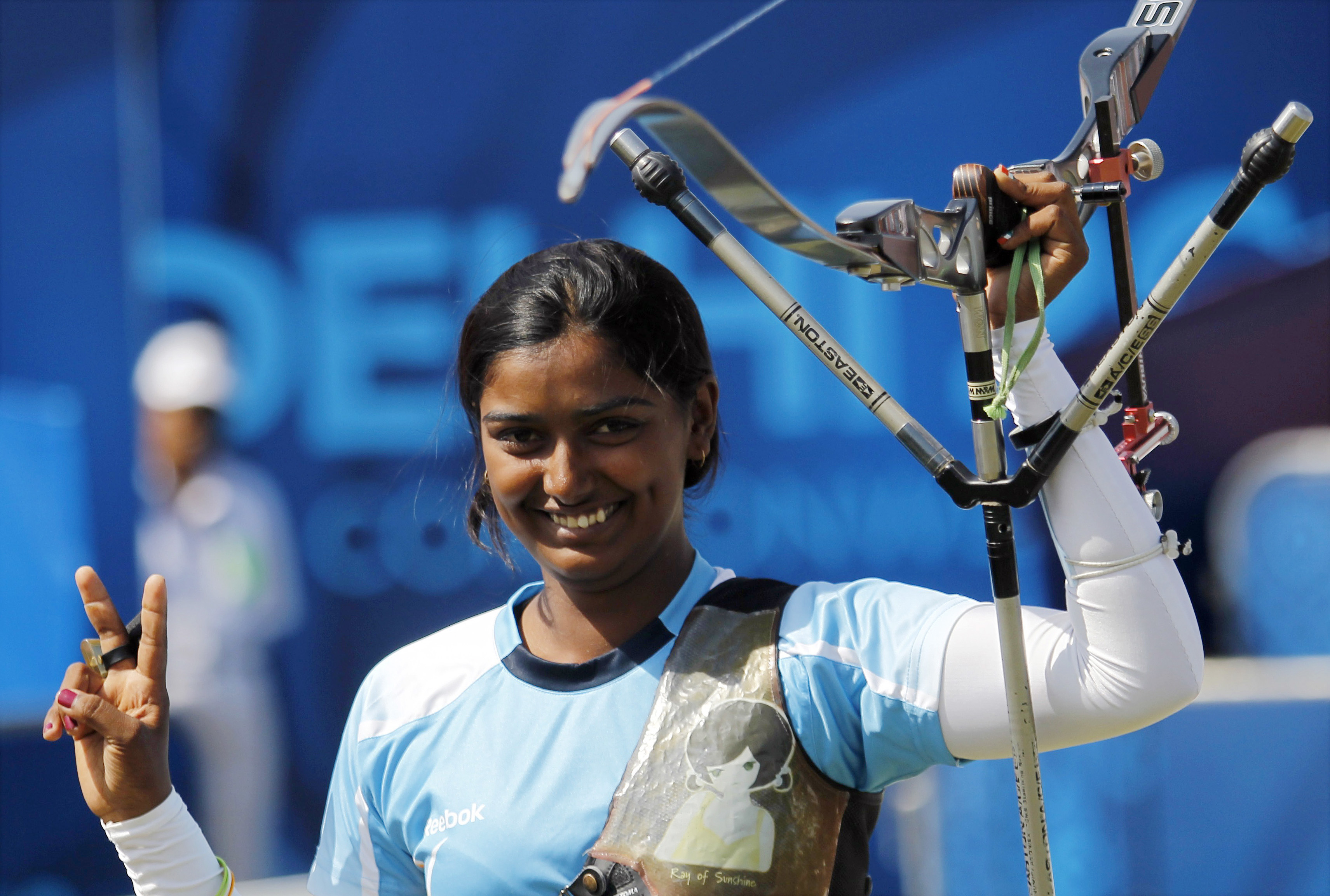 India's Deepika Kumari poses after winning the gold medal in the women's recurve archery finals at the Commonwealth Games in New Delhi