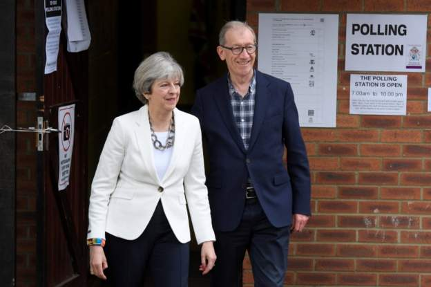 Theresa May casts her vote with her husband
