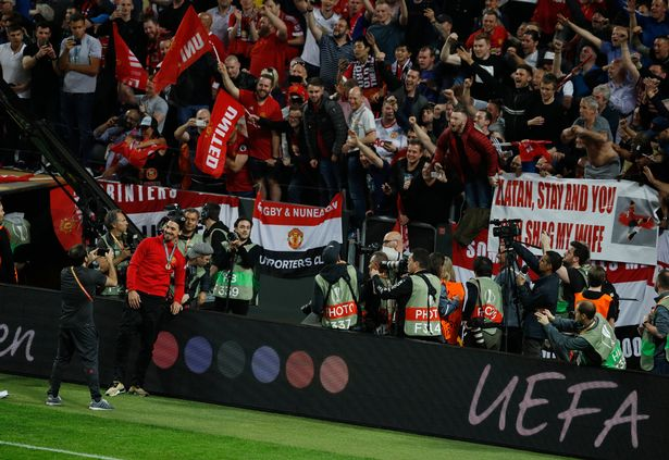 manchester-uniteds-zlatan-ibrahimovic-poses-for-a-photo-in-front-of-a-banner-which-is-about-him