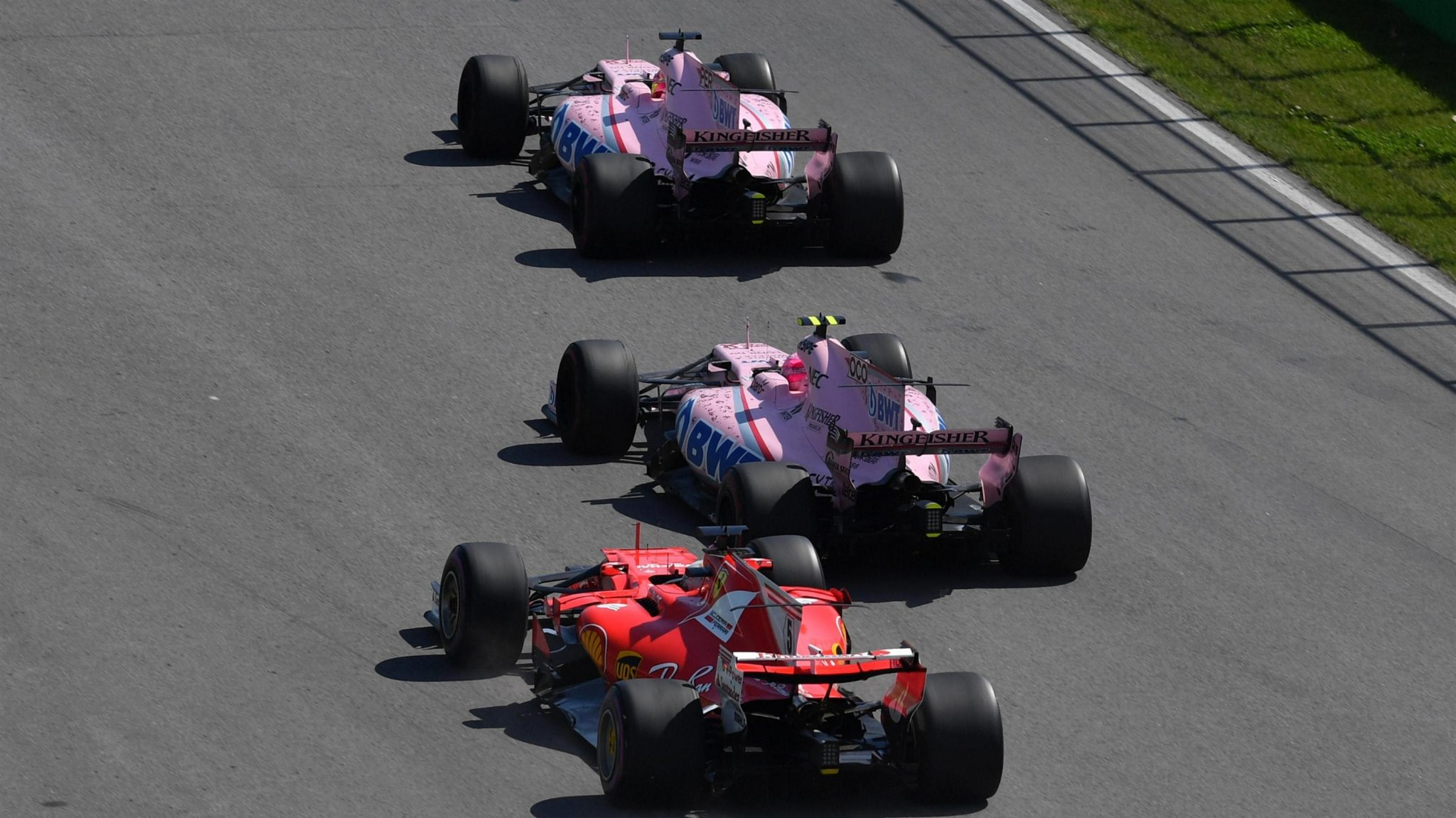 Vettel takes on both Force India cars at turn 1. Image courtesy: Sutton Images