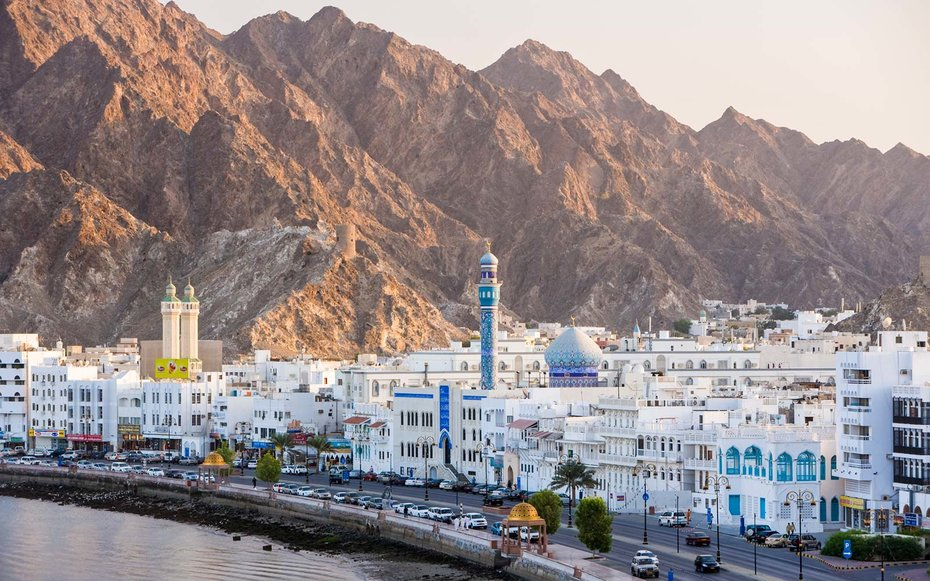 Middle East, Oman, Muscat, Mutrah, elevated view along the Corniche, latticed houses and Mutrah Mosque